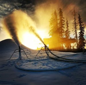 Snow making at sunrise