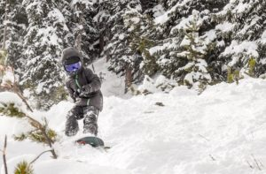 Little ripper, Connor Tyler, enjoying fresh powder on the side of lower Paymaster today.